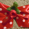 Minnie mouse bows for Mickey ears.<br /> They are red with white polka dots and a small red flower.  I have 12 available,  They were originally $1.50 from disneyland.  I am selling them for $1 each or all 12 for $8.