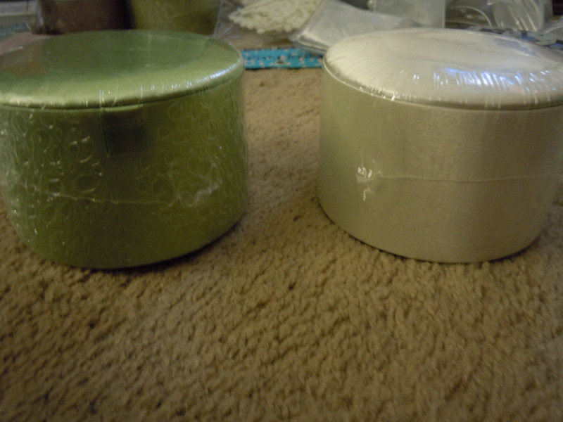 side shot of boxes<br /> <br /> 2 round satin boxes<br /> <br /> one in soft green and one in white.<br /> <br /> 50 cents each