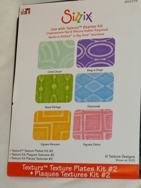 Brand new but out of packaging: Sizzix Texturz Texture Plates Kit #2.  To be used with Texturz Starter Kit.  There are 6 Texture designs.  Package Item number is 654779.<br /> One Set available, $5.