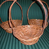 "Small wooden baskets, bottom is about 5 1/2"" across, opening is about 9 3/4"" across.  The basket itself is about 3 1/2"" deep without the handle.  With handle, 12"" high.  There are three baskets available, $2 each."