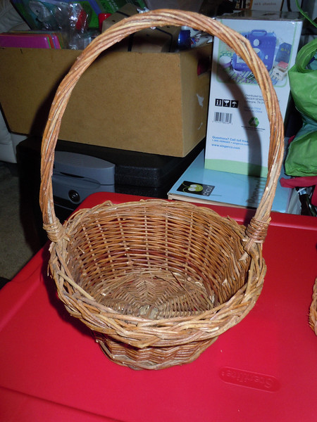 """Wooden flower girl basket, $2, one available.<br /> Base is 5"""" while top of basket is 7.5"""" wide. With handle, the basket is 12"""" high"""