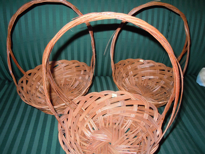 "another angle with flash.<br /> Small wooden baskets, bottom is about 5 1/2"" across, opening is about 9 3/4"" across.  The basket itself is about 3 1/2"" deep without the handle.  With handle, 12"" high.  There are three baskets available, $2 each."