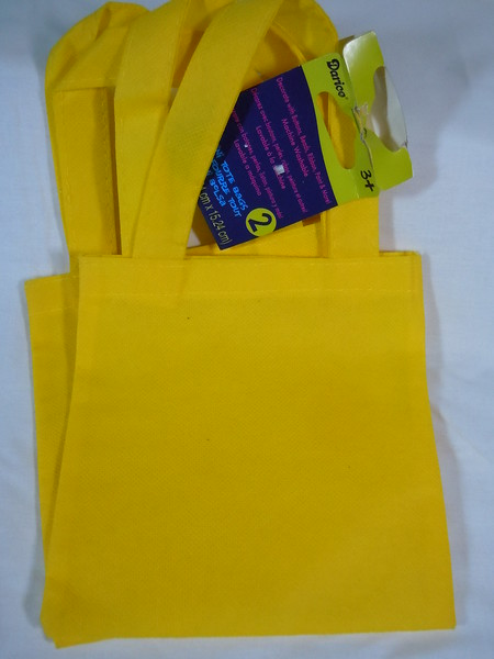 Yellow Mini tote bags, same measurements as the hot pink ones<br /> 1 available, $1