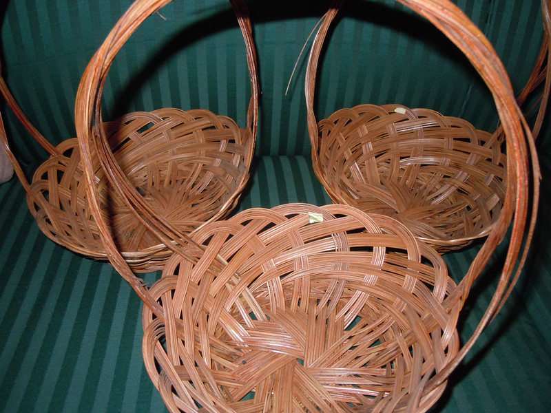 """another angle.<br /> Small wooden baskets, bottom is about 5 1/2"""" across, opening is about 9 3/4"""" across.  The basket itself is about 3 1/2"""" deep without the handle.  With handle, 12"""" high.  There are three baskets available, $2 each."""