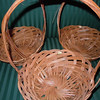 "another angle.<br /> Small wooden baskets, bottom is about 5 1/2"" across, opening is about 9 3/4"" across.  The basket itself is about 3 1/2"" deep without the handle.  With handle, 12"" high.  There are three baskets available, $2 each."