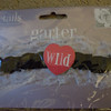 Bachelorette Garter.  Black with heart says WILD.  One available.  50 cents