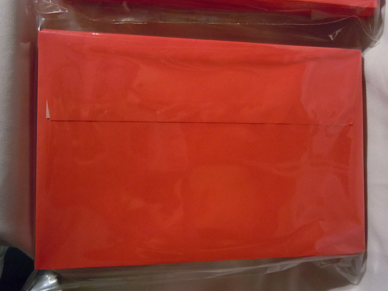 "Ampad brand Release and Seal A9 Greeting Card Size Envelopes, 5 3/4""x8 3/4"", Red.  They have squared flaps and a easy pull seal to close the envelopes.  There are 8 dozen in total.  Each dozen is $1."