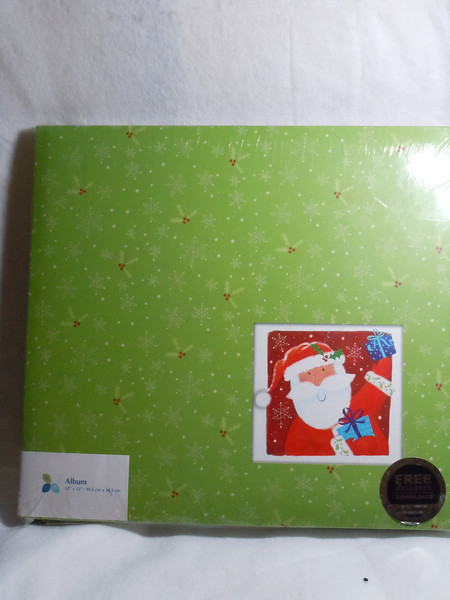 "ATD Brand.  Holiday Design.  It has a holly and snowflake design (Green background) with a picture of Santa in the bottom right corner.  12""x12"". NEW IN PACKAGING, One available.  $5"