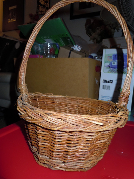"Wooden flower girl basket, $2<br /> <br /> Base is 5"" while top of basket is 7.5"" wide.  With handle, the basket is 12"" high."