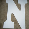 "Close up of N<br /> <br /> white wooden letters, 9"" tall, 5 3/4"" wide, $2 each"