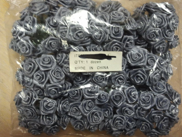 Small Fabric Rosettes.  Great for Favor or invitation tie ons as the stems are wired.  I have two packages of the silver/gray with 1 dozen bundles (of 12 stems each bundle) in each package.  So there are 144 rosettes total in each package.  Each package will be $2.50 or both for $4