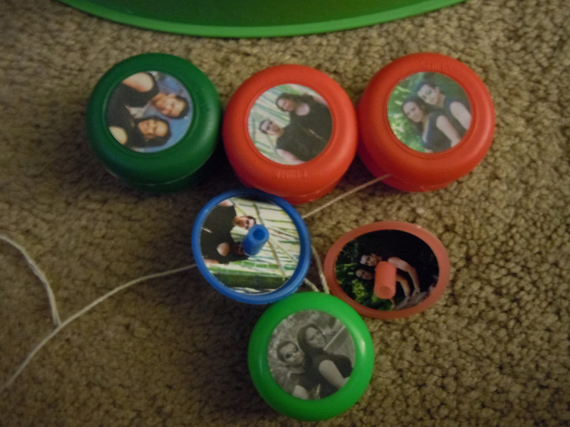Toys I re-crafted for our wedding reception.  We had a lot of children and so this is what I came up with.  Yo yos and spinners with our engagement pictures.