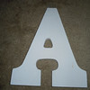 "Close up of A<br /> <br /> white wooden letters, 9"" tall, 5 3/4"" wide, $2 each"