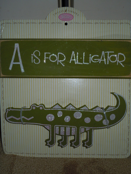 Baby Room Wood Sign Decor.  Two Wood Signs still in packaging.  A is for Alligator and the other is an alligator cut out.  One available, $5