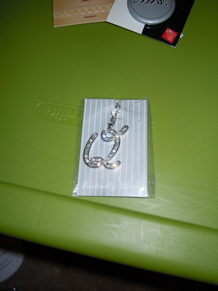"Jeweled pendant/tie on: 1 1/2"" tall x 1 1/4"" wide, one Q initial available, $2"