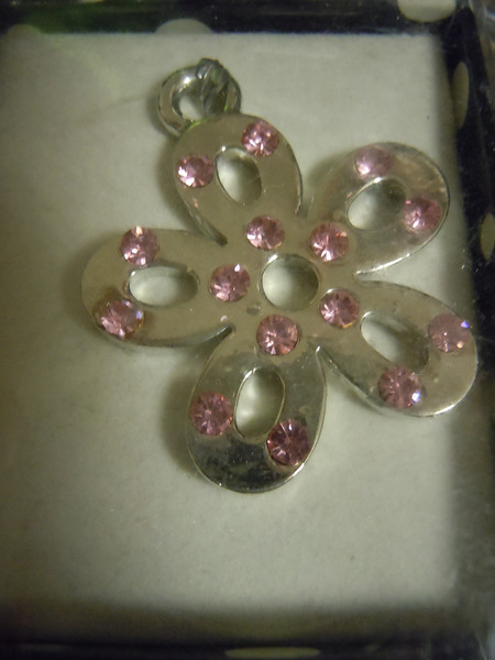 Prima Marketing pendant: flower pendant with light pink gems. one available, $2 each