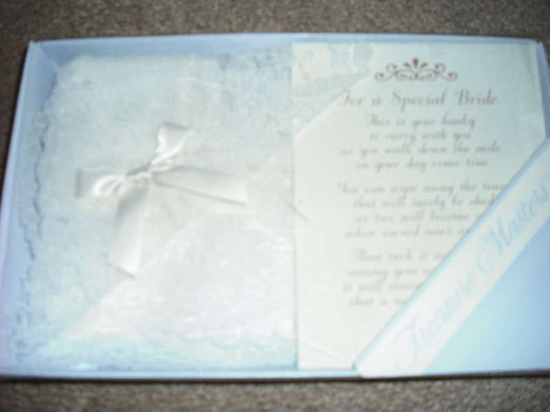 "Sorry, flash makes it look white<br /> <br /> Special Bride Handkerchief, Ivory with ivory ribbon: This is a Treasure Masters ivory ""special bride"" handkerchief. It has lace edging with an ivory ribbon. Special poem is also included in the box: ""For a Special Bride. This is a hanky to carry with you as you walk down the aisle on your day come true. You can wipe away the tears that will surely be shed as two will become one when sacred vows are said. Then tuck it away neatly among your wedding things, it will remind you of the joy that a marriage can bring."" $2"