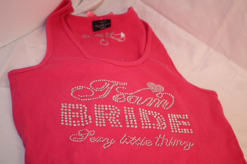 Another shot of the tank top<br /> Victoria Secret's TEAM BRIDE Sexy Little thing tank top in hot pink with jeweled design.  Tried on and washed but not worn.  Size Large, $12