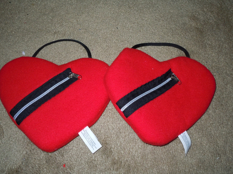 New felt heart shaped bags with zipper and handle.  Mini purses I was going to use them as gifts for my MOHs but ended up getting them a tote for my bachelorette.  3 available, $1 each or all 3 for $2