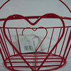 "another angle.<br /> Red wire basket, new with tags. Bottom is 5"" across. The opening is 7"" across. The height of the basket without the handle is 3"" high., $1.50, one available."
