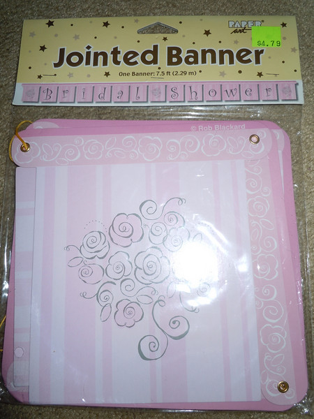 Jointed pink striped/floral Bridal Shower banner.<br /> <br /> One available, $1