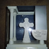 Wilton White cross on platform w/columns.  The cross can be removed from the platform.  There is a metal piece that you can engrave.<br /> <br /> One available, $5