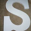"Close up of S<br /> <br /> white wooden letters, 9"" tall, 5 3/4"" wide, $2 each"