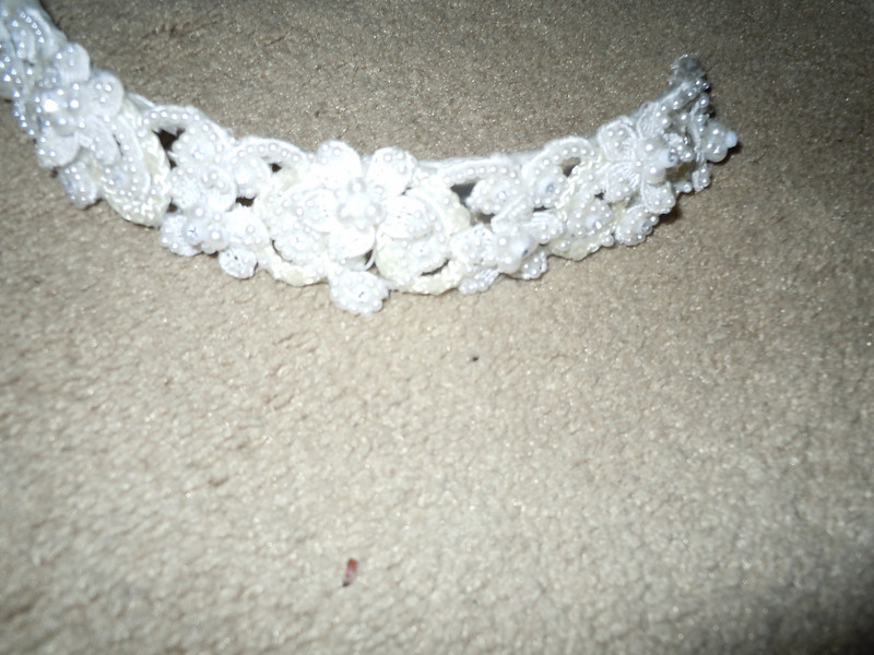 another shot of headband<br /> Headband included in a wedding dress I originally bought for my wedding.  It's pearlized with some floral.<br /> <br /> $1