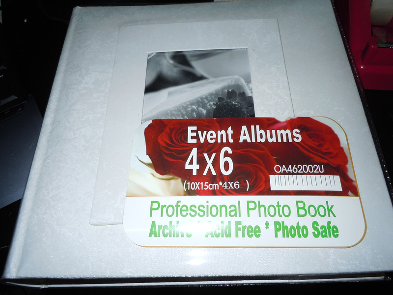 ::UNAVAILABLE::<br /> New White pearlized wedding photo book.  4x6 photos, 50 pages, holds 100 photos total.<br /> <br /> one available, $5