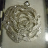 Prima Marketing pendant: rose pendant with clear gems. one available, $2 each