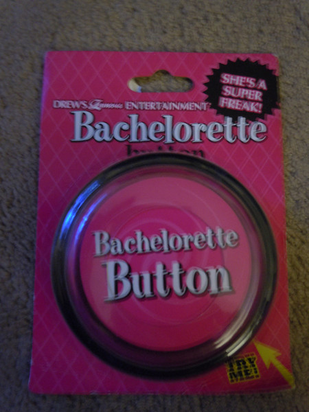 Bachelorette Button.  Press the button and it plays superfreak.  The battery ran out on it but it's new in package.  $2. Only one available.