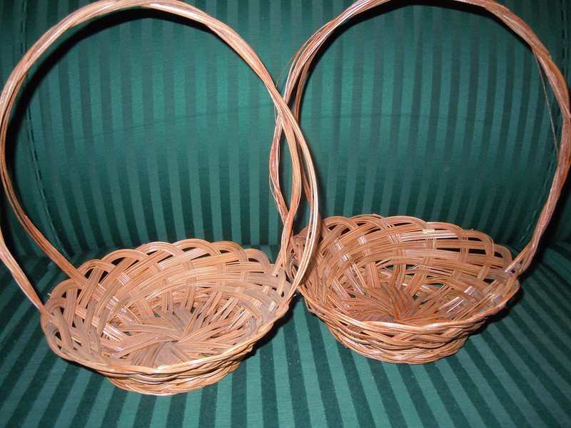 "Small wooden baskets, bottom is about 5"" across, opening is about 8"" across.  The basket itself is about 2 1/2"" deep without the handle.  With handle, 11"" high.  There are two baskets available, $1 each."
