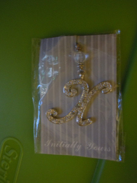 "Jeweled pendant/tie on: 1 1/2"" tall x 1 1/4"" wide, one X initial available, $2"