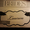 Brides Collection Chair signage, 2 in each package.  1 available in White with black trim and black ribbon. 50 cents each