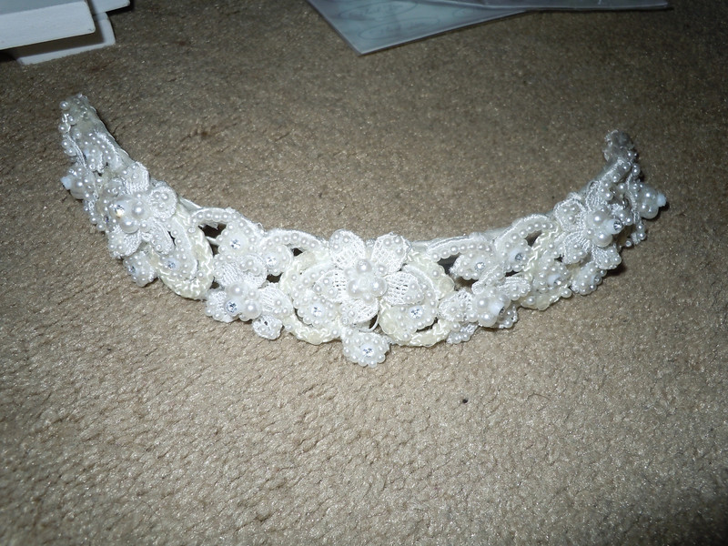 another shot<br /> <br /> Headband included in a wedding dress I originally bought for my wedding.  It's pearlized with some floral.<br /> $1