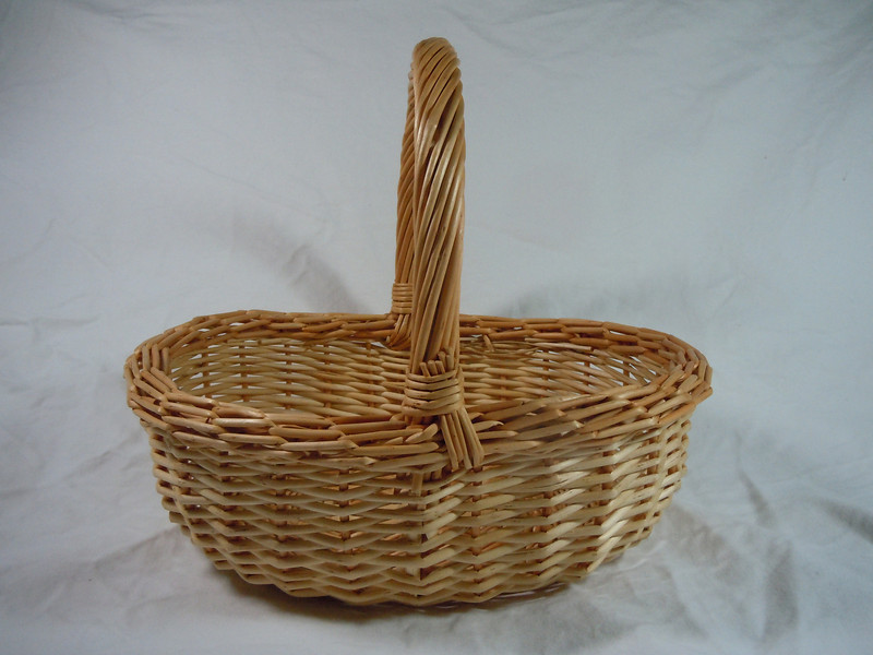 "another angle.<br /> Wooden basket.  Handle does not move.  Bottom is 9"" length and 6 1/2"" the across.  The opening is 10"" length and about 7 1/2"" across.  Height with handle is about 9"".  One available, $3"