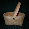"Small Wooden basket with movable handle, $1<br /> Measurements are 4"" in height (without Handle), 6"" width across the opening and 8"" across the length."