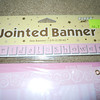 Close up of the top of the packaging.<br /> <br /> Jointed pink striped/floral Bridal Shower banner.<br /> <br /> One available, $1
