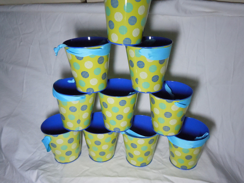 green with blue, white, teal dotted Metal Buckets with Blue grosgrain ribbon handle.  They are about 4 inches in height, 4 inches on the opening, and 2 7/8 inches on the bottom.  10 available.  $1 each or all 10 for $8