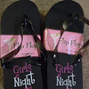 "One size fits most black ""girls night out"" flip flops, $1 each, 2 available. Buy both, $3 total.  They have been sitting in a storage box so may be a bit damaged."