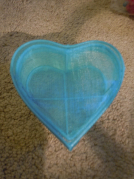 small turquoise heart mesh container, 50 cents. 1 available.