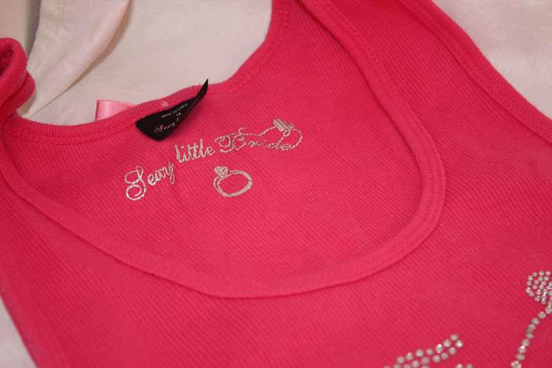 Shot of the tag<br /> <br /> Victoria Secret's TEAM BRIDE Sexy Little thing tank top in hot pink with jeweled design.  Tried on and washed but not worn.  Size Large, $12