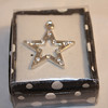 Prima Marketing pendant: Silver Star pendant with clear gems. One available, $2 each
