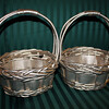 "2 Silver flower girl baskets.  They are metallic in paint with a shimmer and hint of gold.  It is about 7"" in diameter.  About 9"" in height.  Each one will be $7."