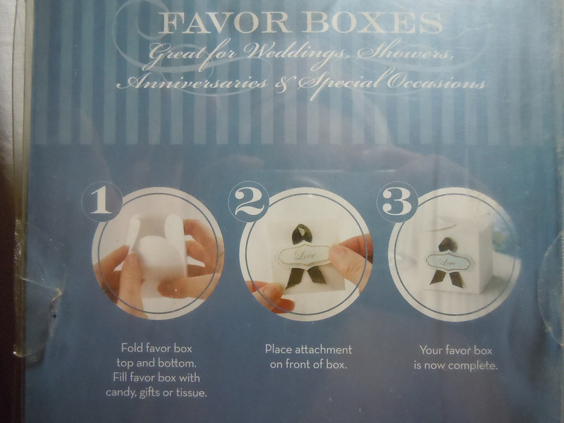 G square Brown Love Favor Boxes Kit.  New in packaging.  **packaging is damaged but not product**.  50 white boxes, 50 brown ribbons, 50 turquoise/brown Love tags.<br /> <br /> 2 sets available, $8 each or both for $15.
