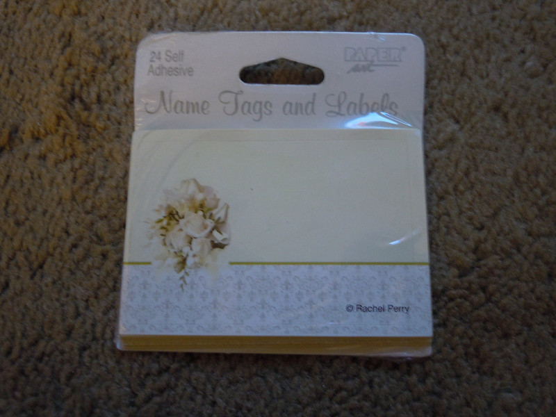 24 self adhesive name tags/labels with cream and rose bouquet.  1 package available, 25 cents