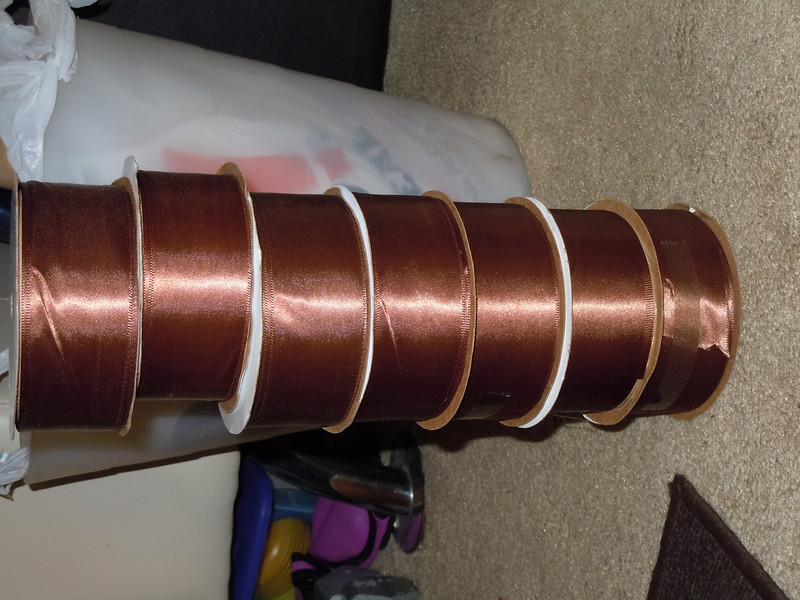 """Milk Chocolate Brown single sided satin ribbon.  About 1 1/2"""" thick and 5 yards per roll, 3 rolls available, $2 each roll or all 3 for $5.."""
