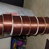 "Milk Chocolate Brown single sided satin ribbon.  About 1 1/2"" thick and 5 yards per roll, 3 rolls available, $2 each roll or all 3 for $5.."