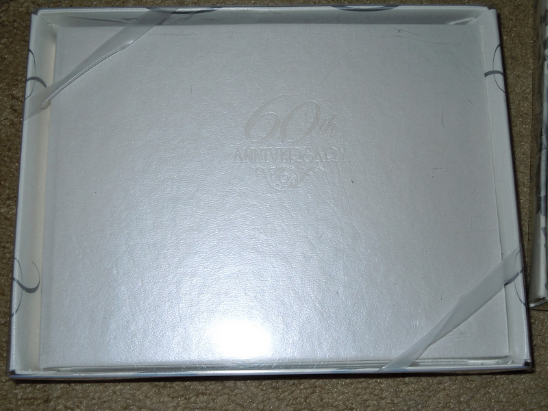 New in box guest book, white.  Front has 60th Anniversary embossed on front, $1 each.  2 available.