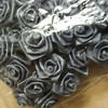 Close up of the rosettes<br /> Small Fabric Rosettes.  Great for Favor or invitation tie ons as the stems are wired.  I have two packages of the silver/gray with 1 dozen bundles (of 12 stems each bundle) in each package.  So there are 144 rosettes total in each package.  Each package will be $2.50 or both for $4